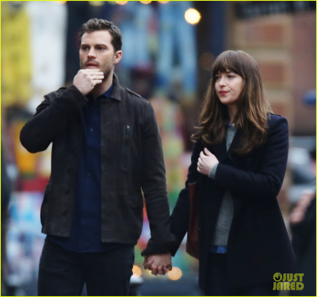 dakota-johnson-jamie-dornan-hold-hands-on-fifty-shades-darker-set-01