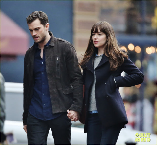 dakota-johnson-jamie-dornan-hold-hands-on-fifty-shades-darker-set-15